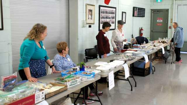 22 volunteers with baked goods end jam